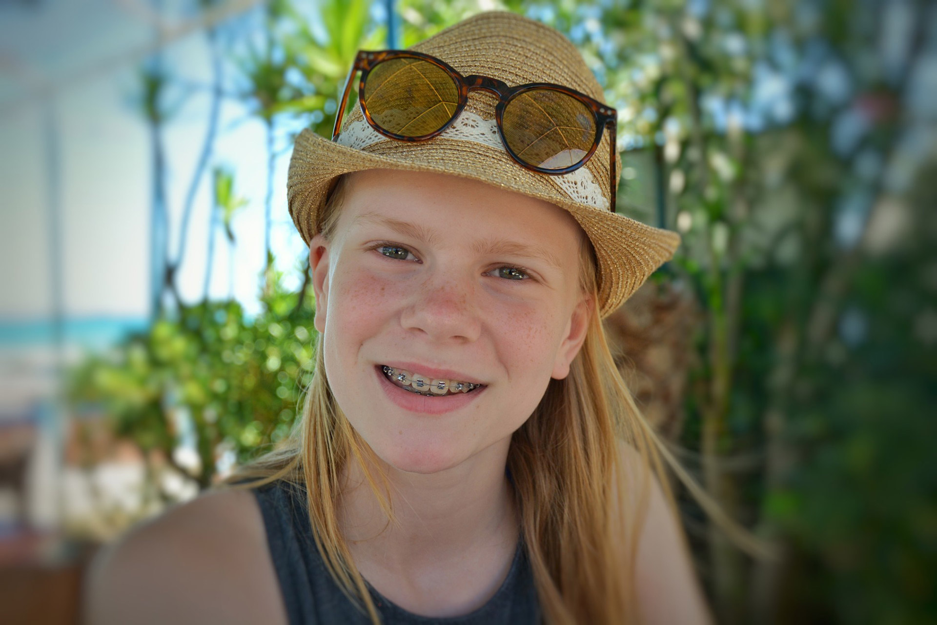 Pre-teen girl wearing braces in summer