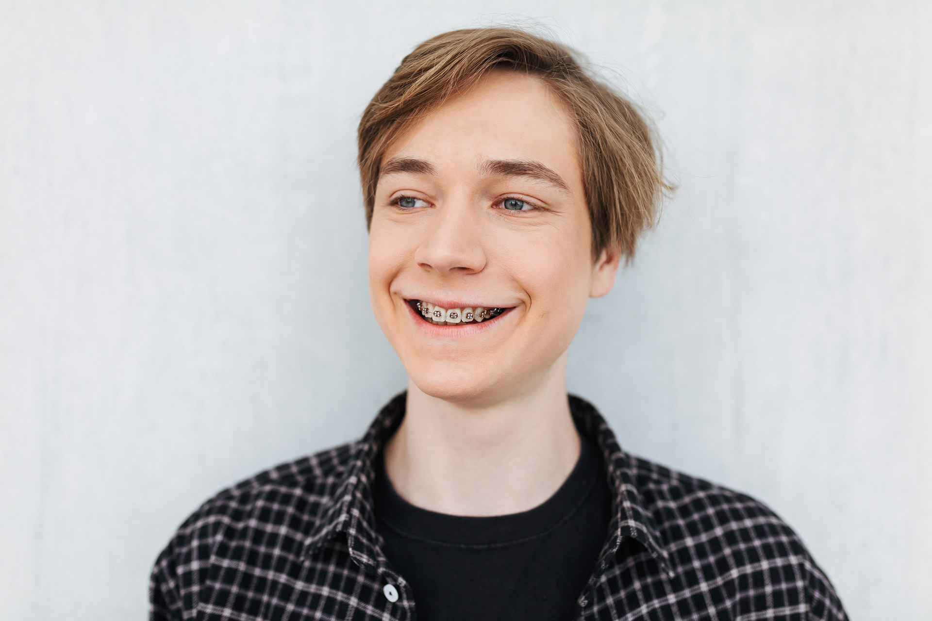 Young teen boy in braces smiling