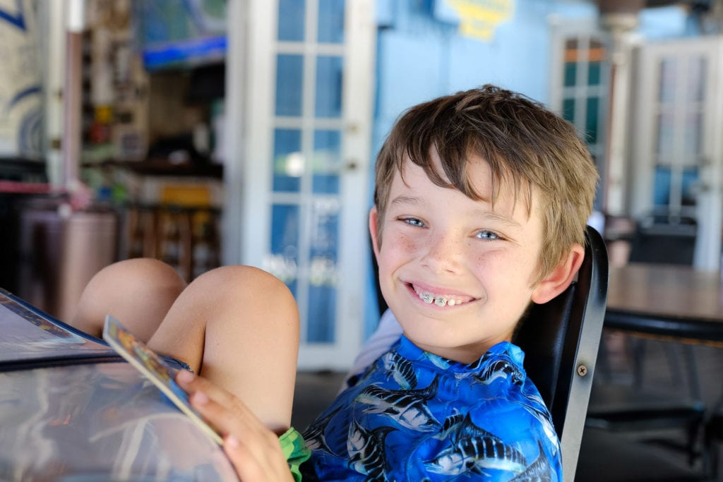 Orthodontics for children, young boy in braces
